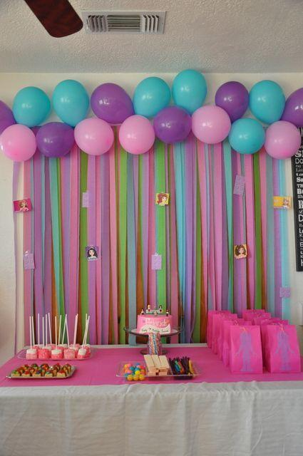 Baby shower table - with lots of balloons and a cake