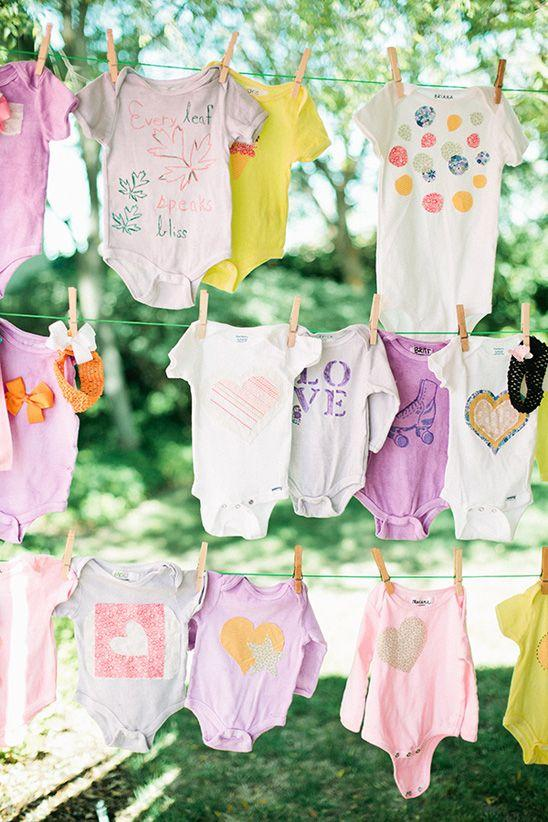 Creative garland made of baby clothes - for outdoor baby shower celebration