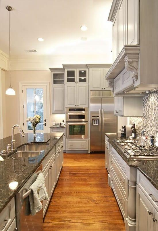 Dark granite countertops - used in a white kitchen interior
