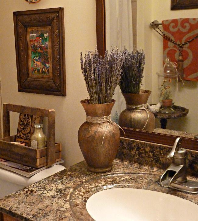 Gold and brown bathroom granite countertops - and copper sink faucet