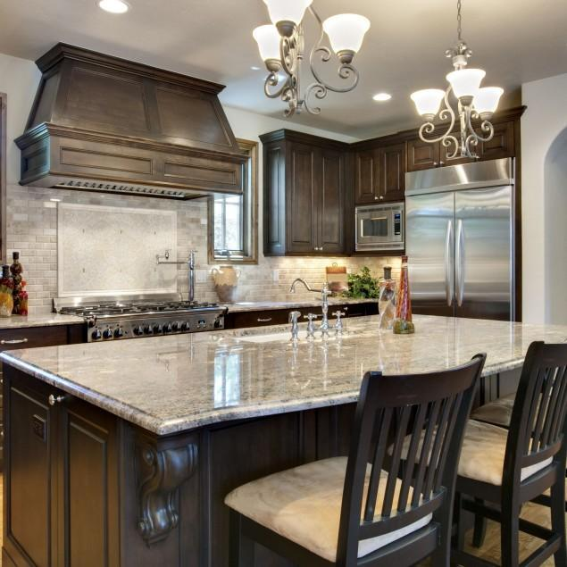 Kitchen island with granite surface on the top