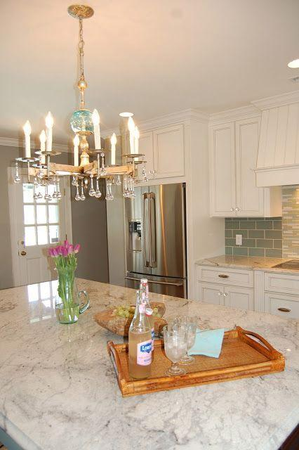 Kitchen island with granite countertops - in a traditional white room