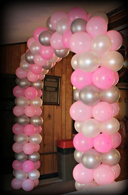 pink arch made of balloons for baby shower