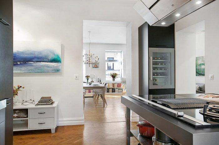 Scandinavian interior design - a look from the kitchen to the living room