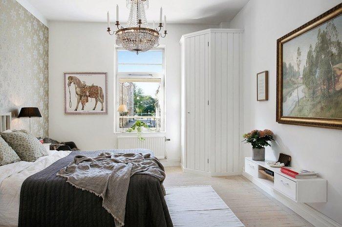 Scandinavian master bedroom - with beautiful classic chandelier
