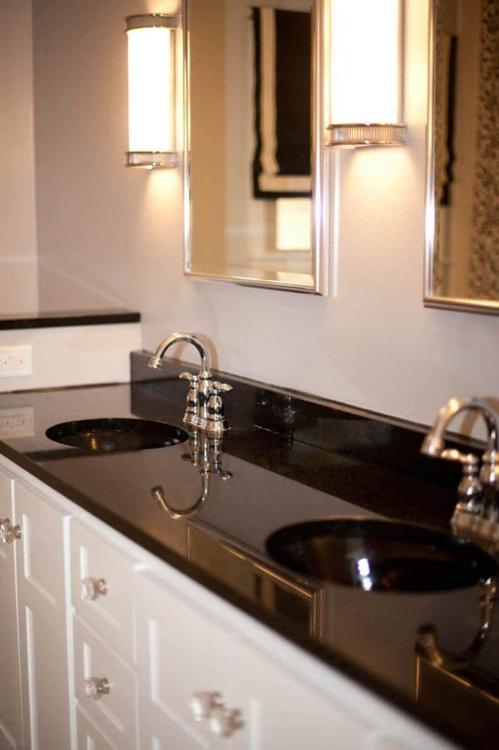 Shiny black bathroom countertops - made from granite material