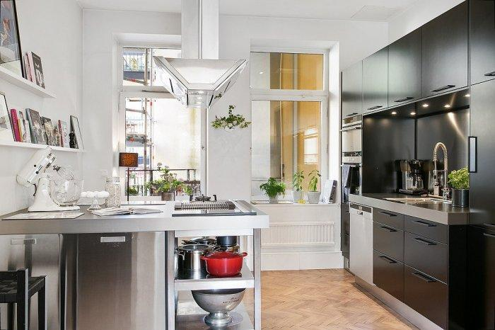 Small Scandinavian kitchen - with black cabinets and white walls