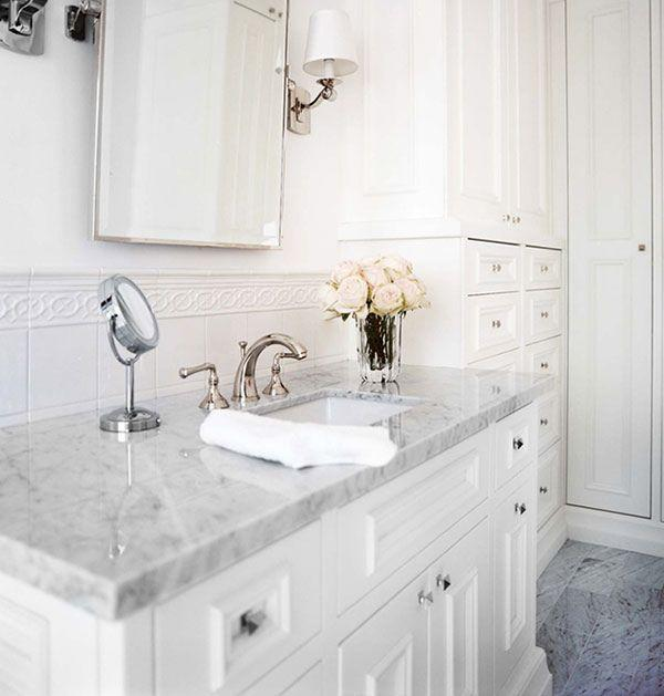 Traditional bathroom granite countertops - on a small vanity with drawers