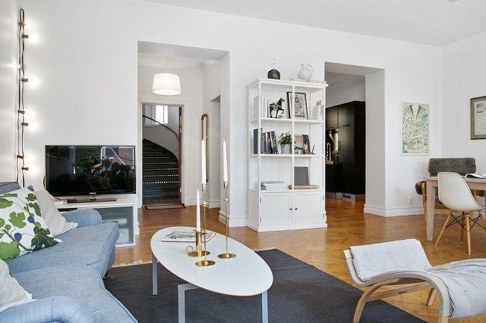 White Scandinavian living room - with cozy dark rug