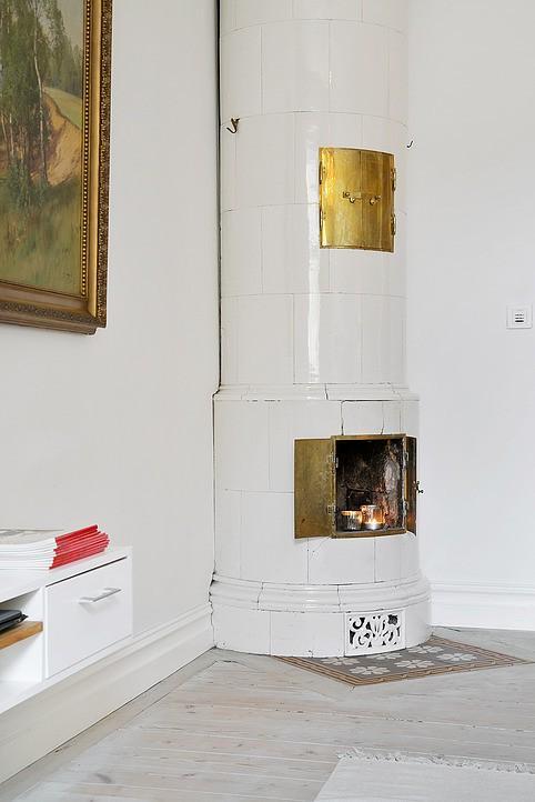 White fireplace - in a Swedish loft