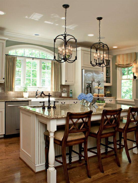 White kitchen island - with dark granite countertops