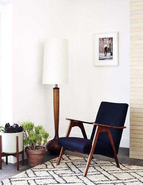 White mid-century modern lamp - placed near a graphic rug