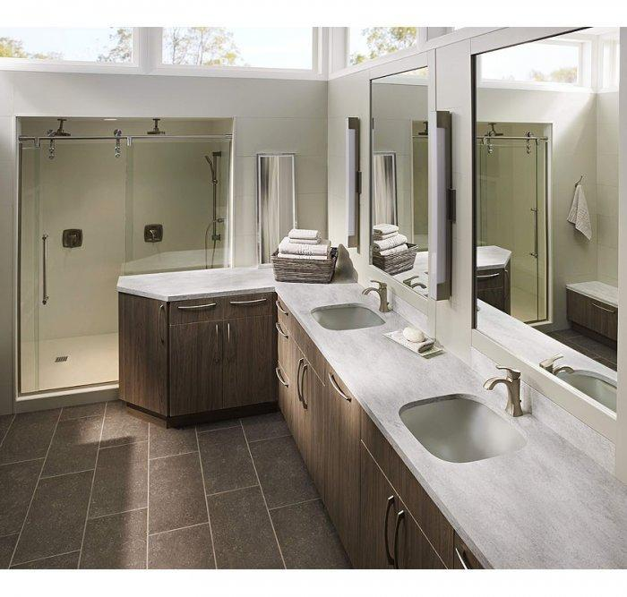 American bathroom with Corian countertops - with two sinks and mirros