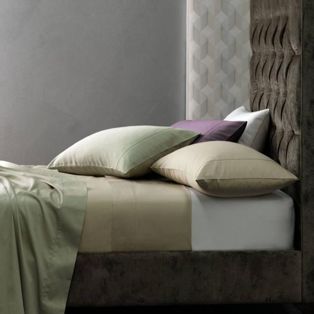 Natural colored bedroom with velvet headboard