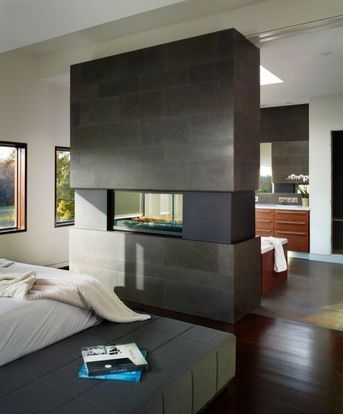 Bedroom electric fireplace - in a minimalist home
