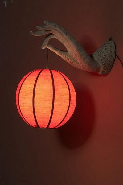 Chinese lantern - in red color hanged on the wall