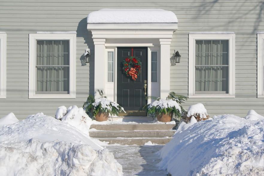 Front door with red Christmas wreath