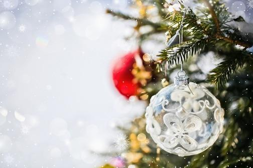 Christmas ornament - white ball - hanged on a tree