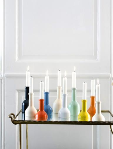 Colorful candleholders - on a glass table