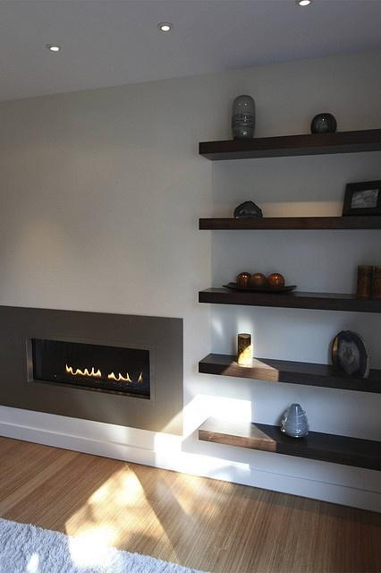 Contemporary fireplace decorating idea 1 - with floating shelves