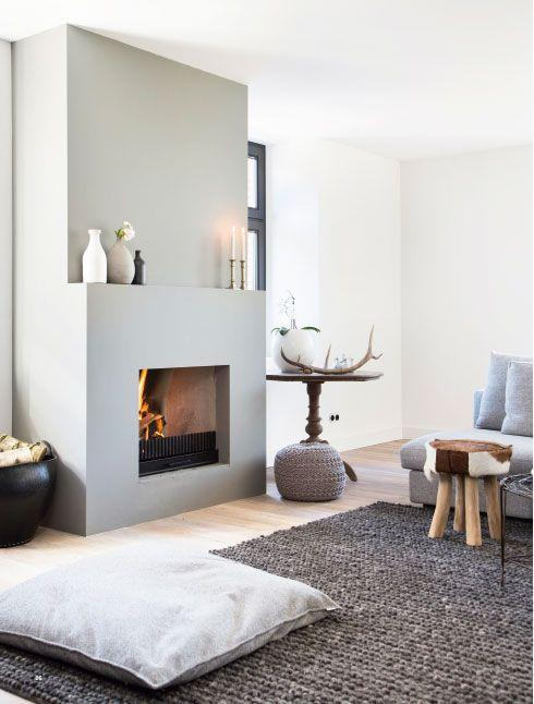 Contemporary fireplace decorating idea 4 - with cases and candles