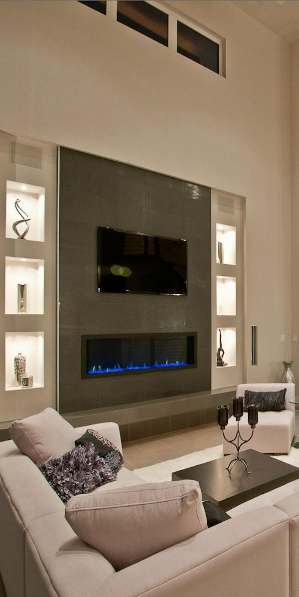 Contemporary fireplace decorating idea 5 - with illuminated niches