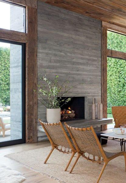 Contemporary fireplace decorating idea - with flowers and white pot