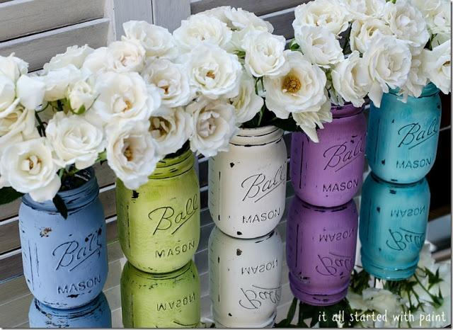 DIY mason jars 1 - in various colors and white flowers in them