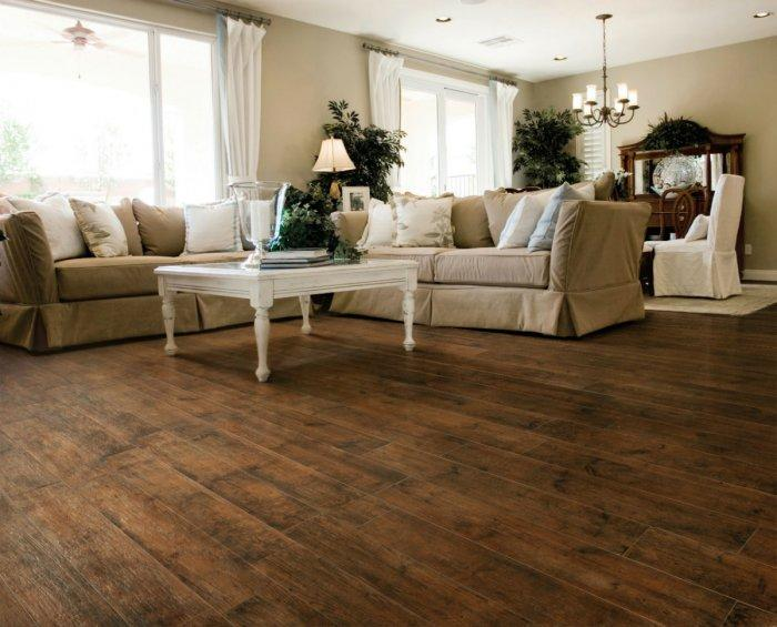 Dark beige living room paint - and natural wood flooring