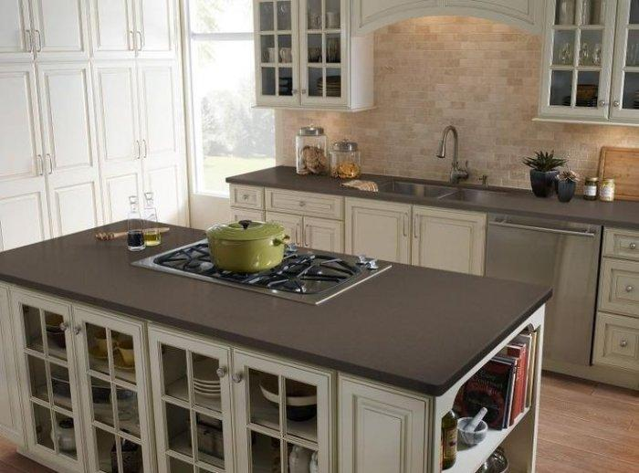 Dark kitchen with Corian countertops - with large kitchen island