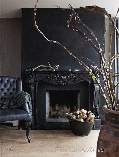 Dark living room paint - and black leather armchair