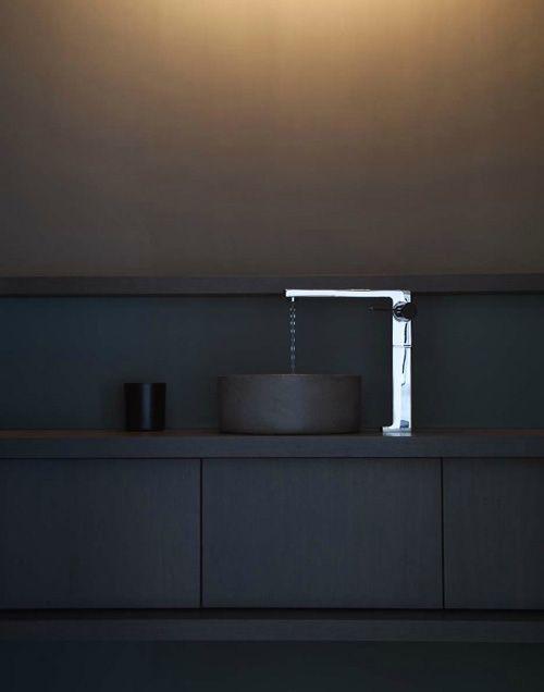 Elegant chrome bathroom faucet - in a black private room