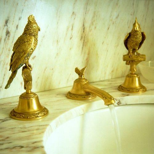Expensive goldern bathroom faucet - with marble countertops