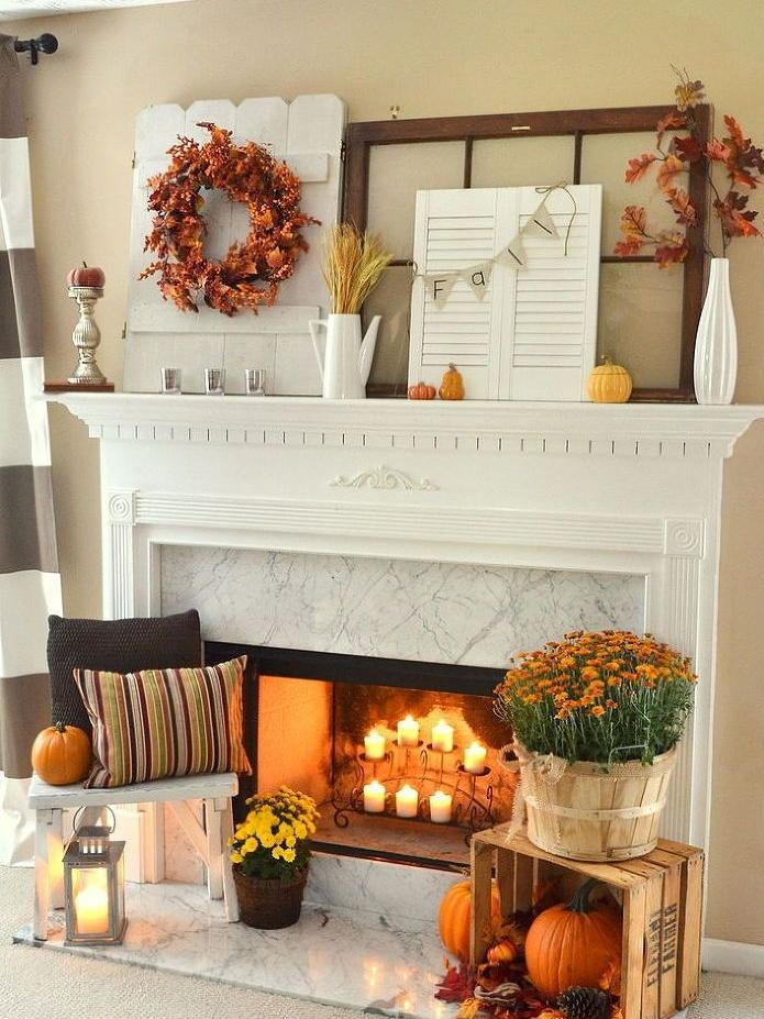 Fall fireplace decorating idea - with leaves, pumpkins and flowers