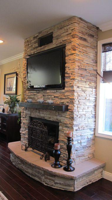 Fireplace decorating idea with TV 2 - and ancient black candleholders