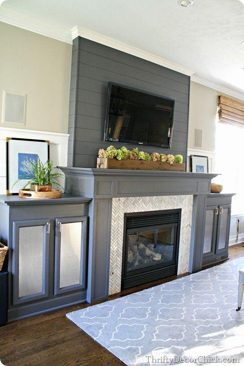 Fireplace decorating idea with TV 7 - and grey cupboards beside
