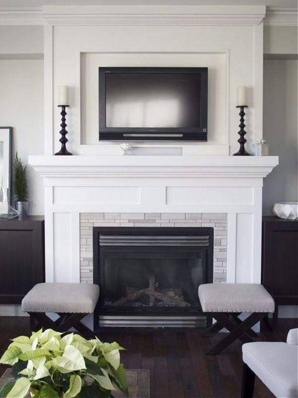 Fireplace decorating idea with TV 8 - and elegant black candleholders
