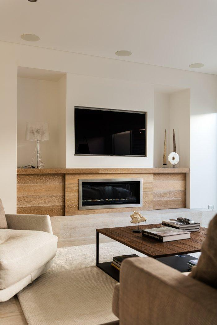 Fireplace decorating idea with TV - and lamps and artifacts