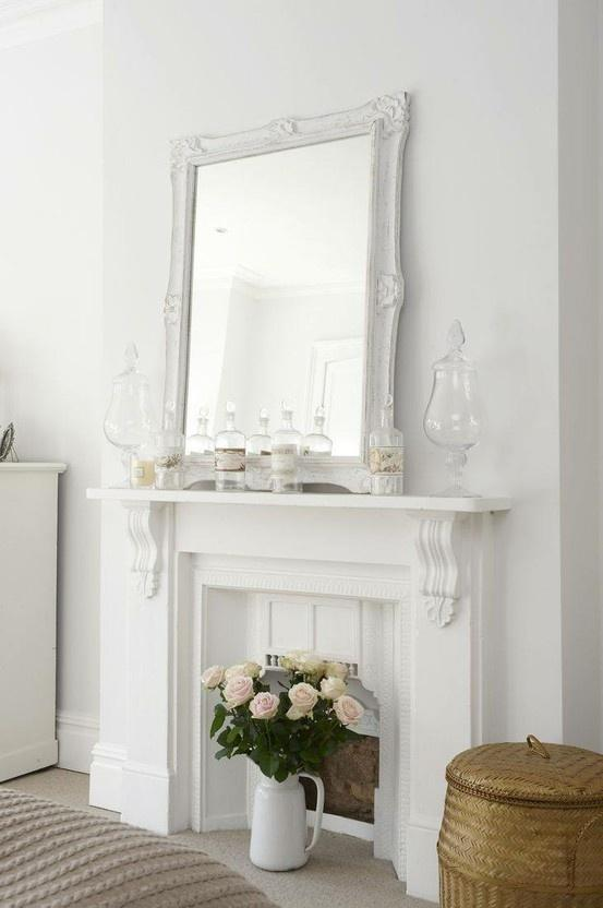 Fireplace decorating idea with mirror - and empty glass bottles