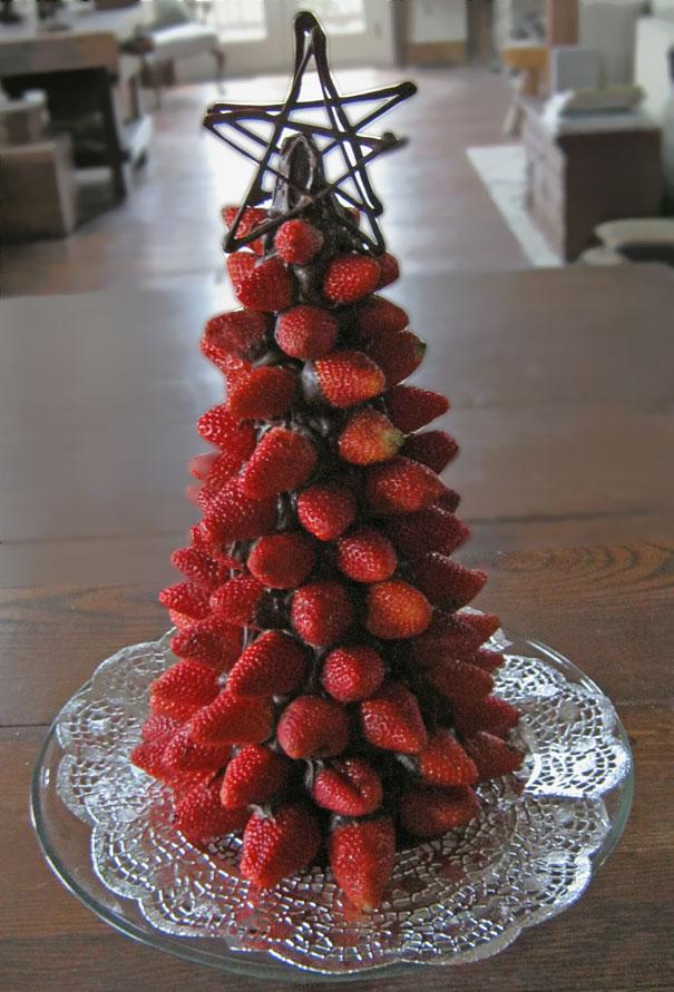 Fruity Christmas tree - made of piled strawberries