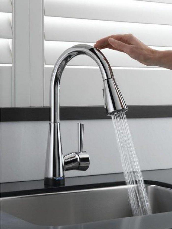 Glossy Silver Single Lever Kitchen Faucet On Black Counter