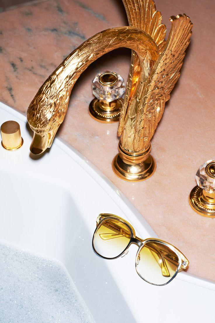 Golden bathroom faucet - inside a luxurious private room