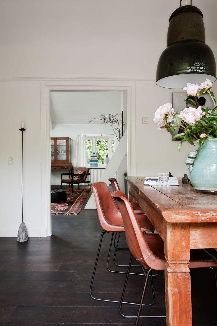 Large black industrial pendant - inside a modern vintage dining room