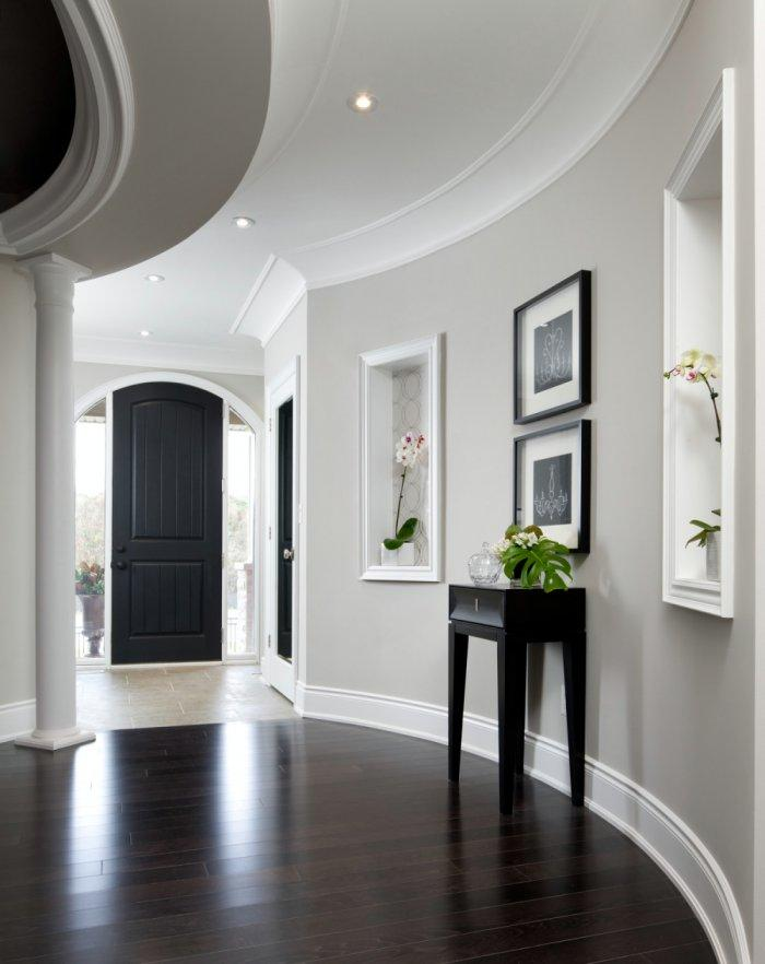 Luxurious black hallway door - inside an impressive mansion