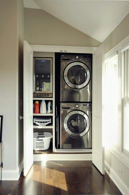 Luxurious small laundry room - with two mashines in it