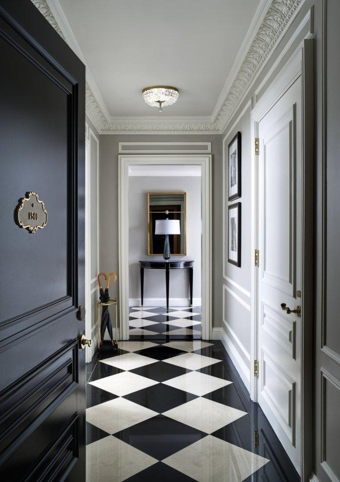 Massive black hallway door - inside a luxurious apartment