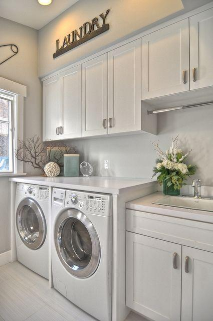 Modern laundry cabinets - above the washing mashines