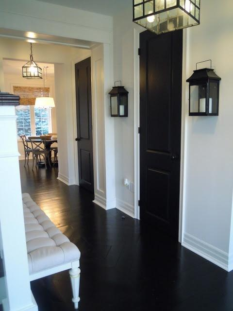 Narrow black hallway door - with traditional design