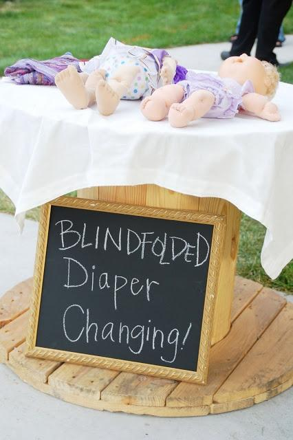 Outdoor baby shower decor - blindfolded diaper changing