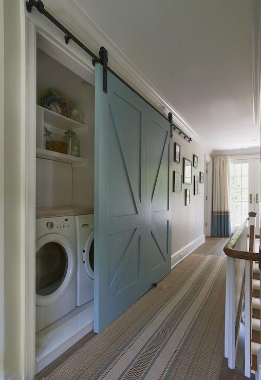 Pale blue sliding door - hiding the laundry
